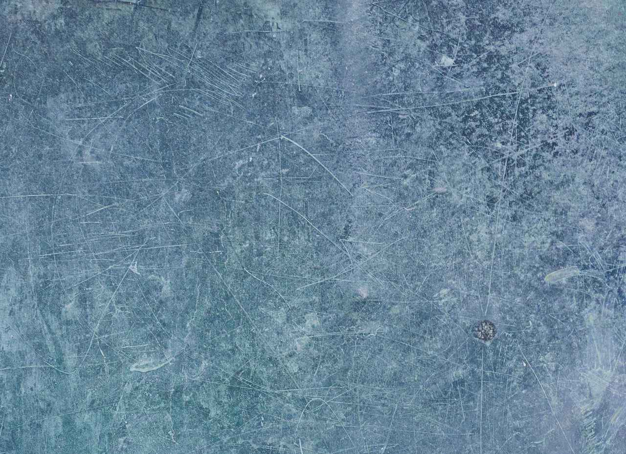blue-scratched-metal-sheet-free-texture