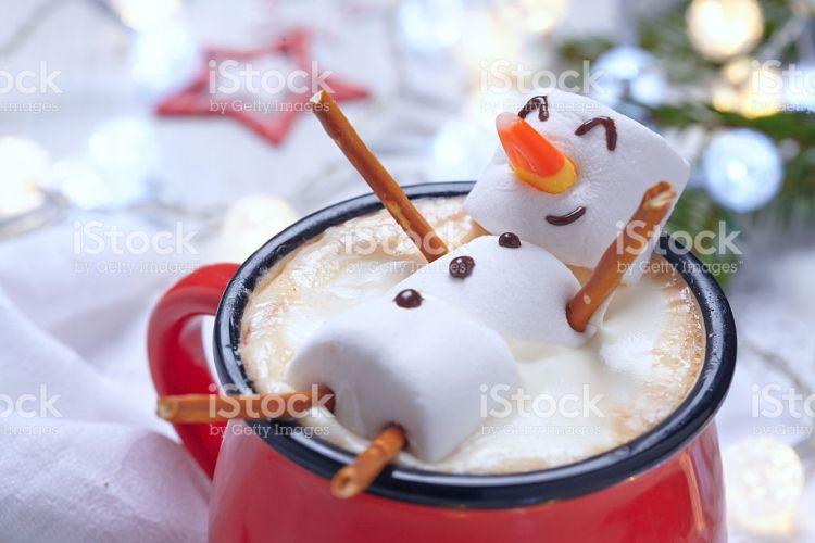 Hot Chocolate with Melted Snowman - Stock Image