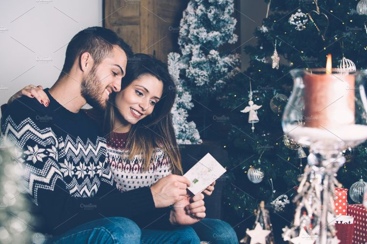 Lovers reading Christmas greetings